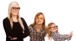 Three crazy girls. With glasses on white background Royalty Free Stock Photography