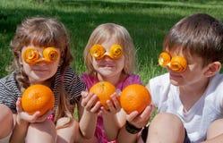 Three crazy little orange lovers Stock Photo