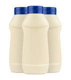 Three cream mayonnaise plastic bottles with no label and blue ca. Front view of three cream mayonnaise plastic bottles with no label and blue cap on white stock photos