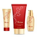 Three cream tubes, Golden and red Stock Images