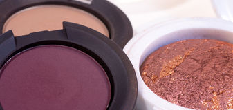 Three creamy pink and brown eye shadows for make up.  Royalty Free Stock Photos