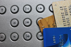 Three Credit card and push button Royalty Free Stock Photo