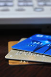 Three Credit card and telephone. Three different color credit card, and a telephone of image in background, which is out of focus Royalty Free Stock Photos