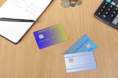Three credit cards on a desk with notepad and calculator Royalty Free Stock Photo