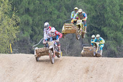 Three crew of sidecars are jumping in terrain Stock Photo