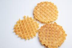 Three crispy belgian waffles on white tablecloth stock photos
