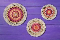 Three crochet pattern coasters Royalty Free Stock Photography