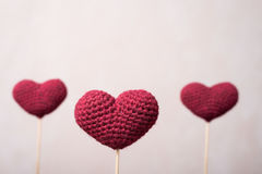 Three crocheted hearts on wooden sticks Royalty Free Stock Image