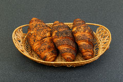 Three croissant in basket Royalty Free Stock Photo