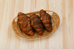 Three croissant in basket Stock Images
