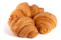 Three croissant isolated on white background closeup.  royalty free stock image