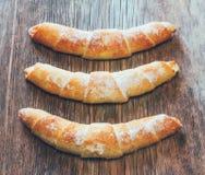 Three croissant on wooden background Stock Photo