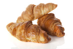 Three croissants. An arrangement of three delicious and crispy croissants Royalty Free Stock Photo