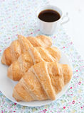 Three croissants with coffee on the white table Royalty Free Stock Photo