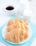 Three croissants with coffee on the white table Royalty Free Stock Photos