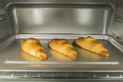 Three Croissants In Oven Royalty Free Stock Image