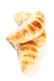 Three croissants  on white Stock Photos