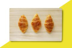Croissant on a wooden tray stock image