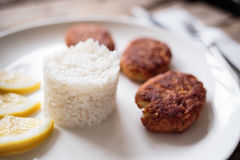 Three croquettes on white ceramic plate Stock Images
