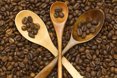 Three cross lay wooden spoon on coffee beans Stock Photography