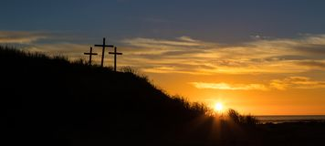 Easter hill beach. Three cross on a sand hill as the sunsets Royalty Free Stock Photo