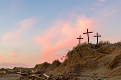 Strom dune of salvation. Three cross on a sand hill as the sunsets stock photos