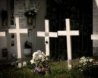 Three crosses in the cemetery stock images