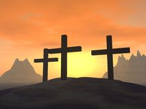 Three crosses. On a hill on a background of a sunset Stock Photos
