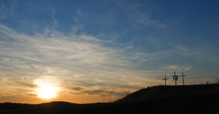 Three crosses. On hilltop at sunset Stock Image