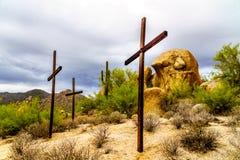 Three Crosses Cacti, Shrubs and large Boulders in the Arizona Desert Royalty Free Stock Image