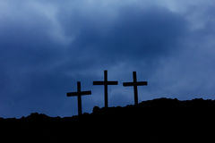 Three crosses on Calvary. Three crosses on Golgotha ​​among the clouds Royalty Free Stock Photos