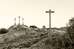 Three crosses carved in the stone on fund to the evening Stock Photo