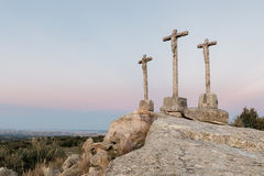 Three crosses carved in the stone on fund to the evening Stock Images