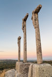 Three crosses carved in the stone on fund to the evening Royalty Free Stock Images