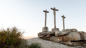 Three crosses carved in the stone on fund to the evening Royalty Free Stock Photography