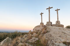Three crosses carved in the stone on fund to the evening Stock Image