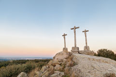 Three crosses carved in the stone on fund to the evening Stock Photos