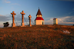 Three crosses and chapel on a hill Royalty Free Stock Image