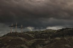Three Crosses On A Hill Stock Images