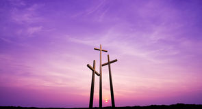 Three crosses on a hill over bright sky Stock Image
