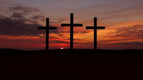 Three crosses on a hill with red  sunset. Royalty Free Stock Photos