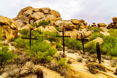 Three Crosses on a Hillside in a Desert landscape Royalty Free Stock Photo