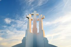 The Three Crosses monument overlooking Vilnius Old Town on sunset. Vilnius landscape from the Hill of Three Crosses, Lithuania. Stock Photos