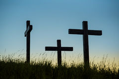 Three crosses ona hill with grass Royalty Free Stock Photo