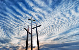 Three crosses over bright cloudy sky Royalty Free Stock Photo