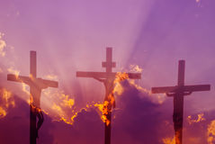 Three crosses over bright cloudy sky Stock Images