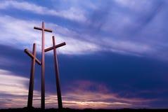 Three crosses over bright dramatic sky Stock Photos