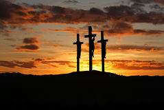 Three crosses over bright sunset with copy space Stock Photos