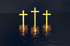 Three crosses over water glow in dark Royalty Free Stock Photos