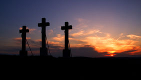 Three crosses on sunset. Three crosses on sunset in hill royalty free stock photos